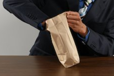 man taking out something from brown lunch bag