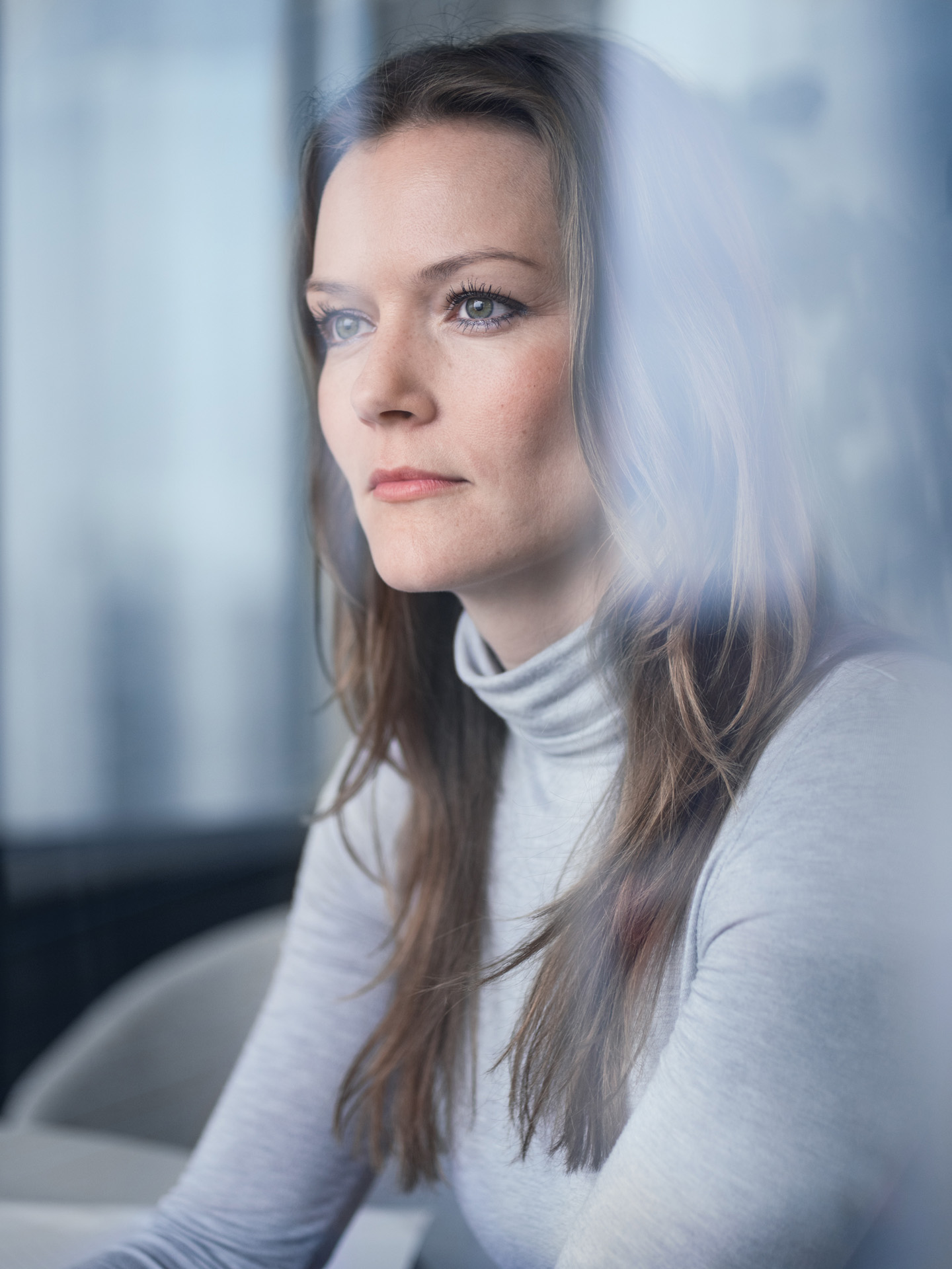 portrait of brown haired woman wearing grey turtleneck by Alexi Hobbs for WSP