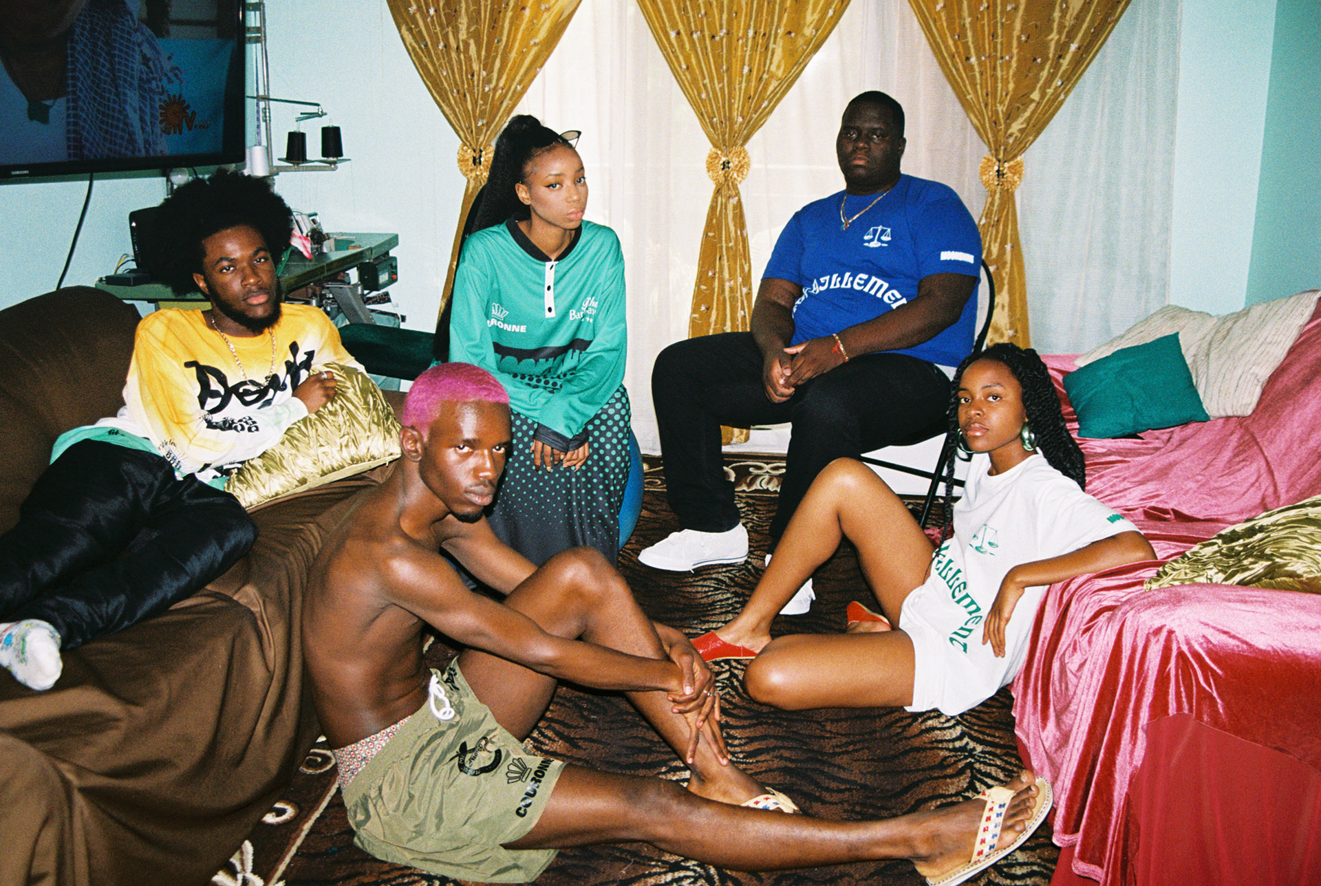 group of black models sitting in lounge by Oumayma B Tanfous for Moonshine international sapologie with Nataal