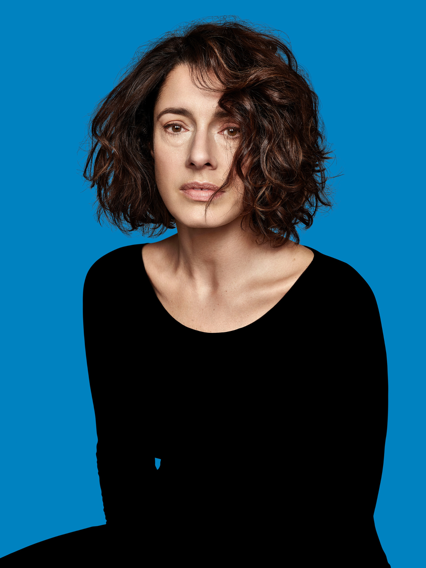 actress Marie-Helene Thibault on blue background by Maxyme G Delisle for Duceppe Theatre with Publicis