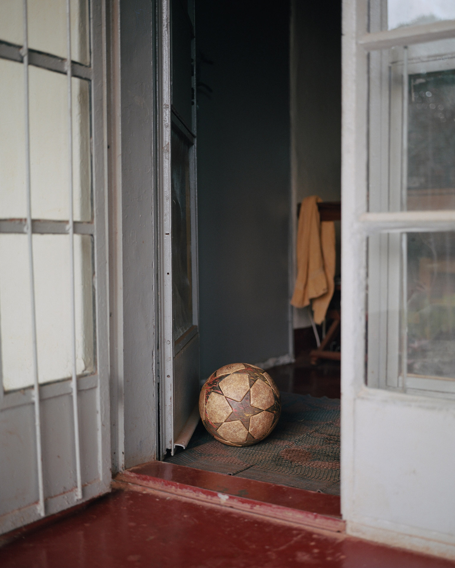 beaten soccer ball at the entrance of a house by Alexi Hobbs in Uganda for Football for good with Sportsnet