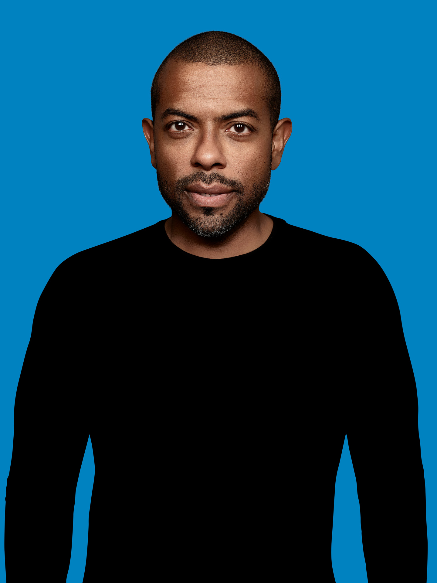 actor Frederic Pierre on blue background by Maxyme G Delisle for Duceppe Theatre with Publicis