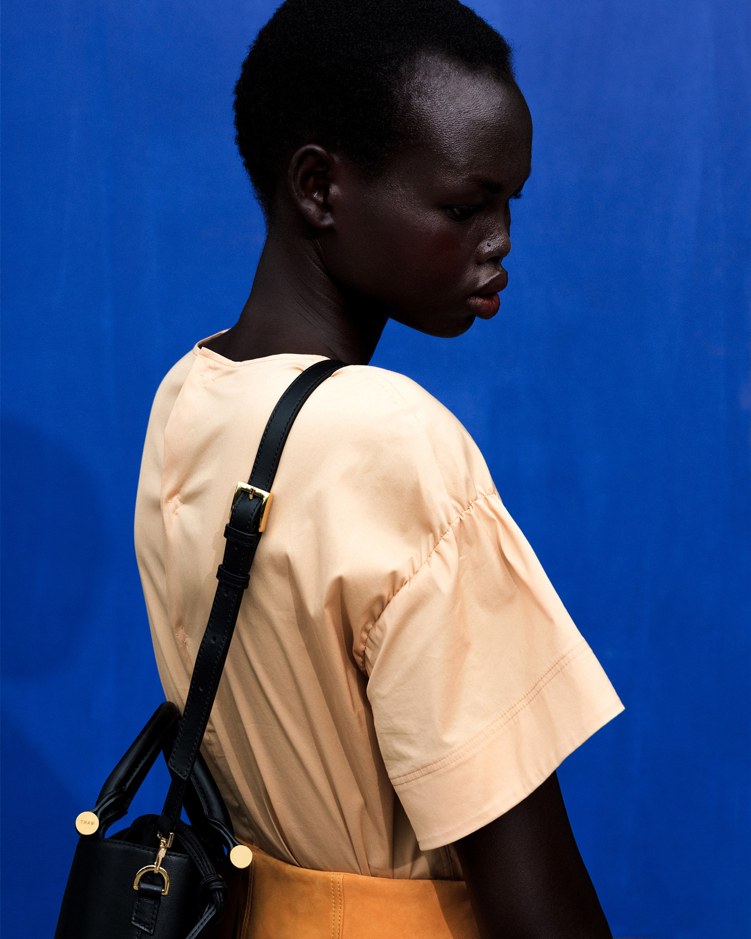 black female model wearing bag from Want Les Essentiels from pre summer-spring 2019 collection photographed by Alexi Hobbs