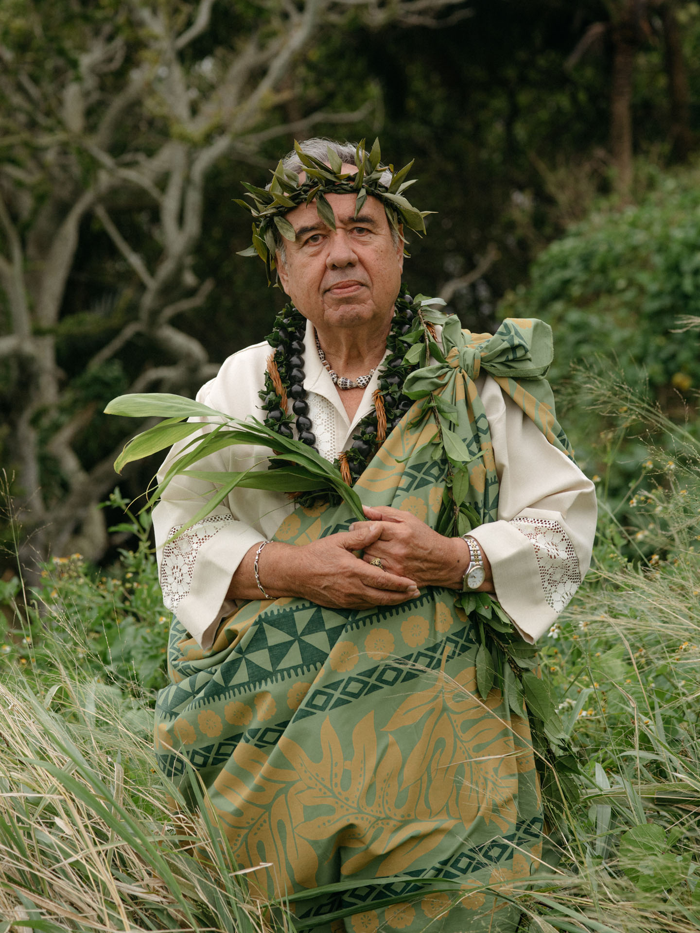 traditional native hawaiian priest in middle of a jungle by Alexi Hobbs in Hawai'i for enRoute Magazine