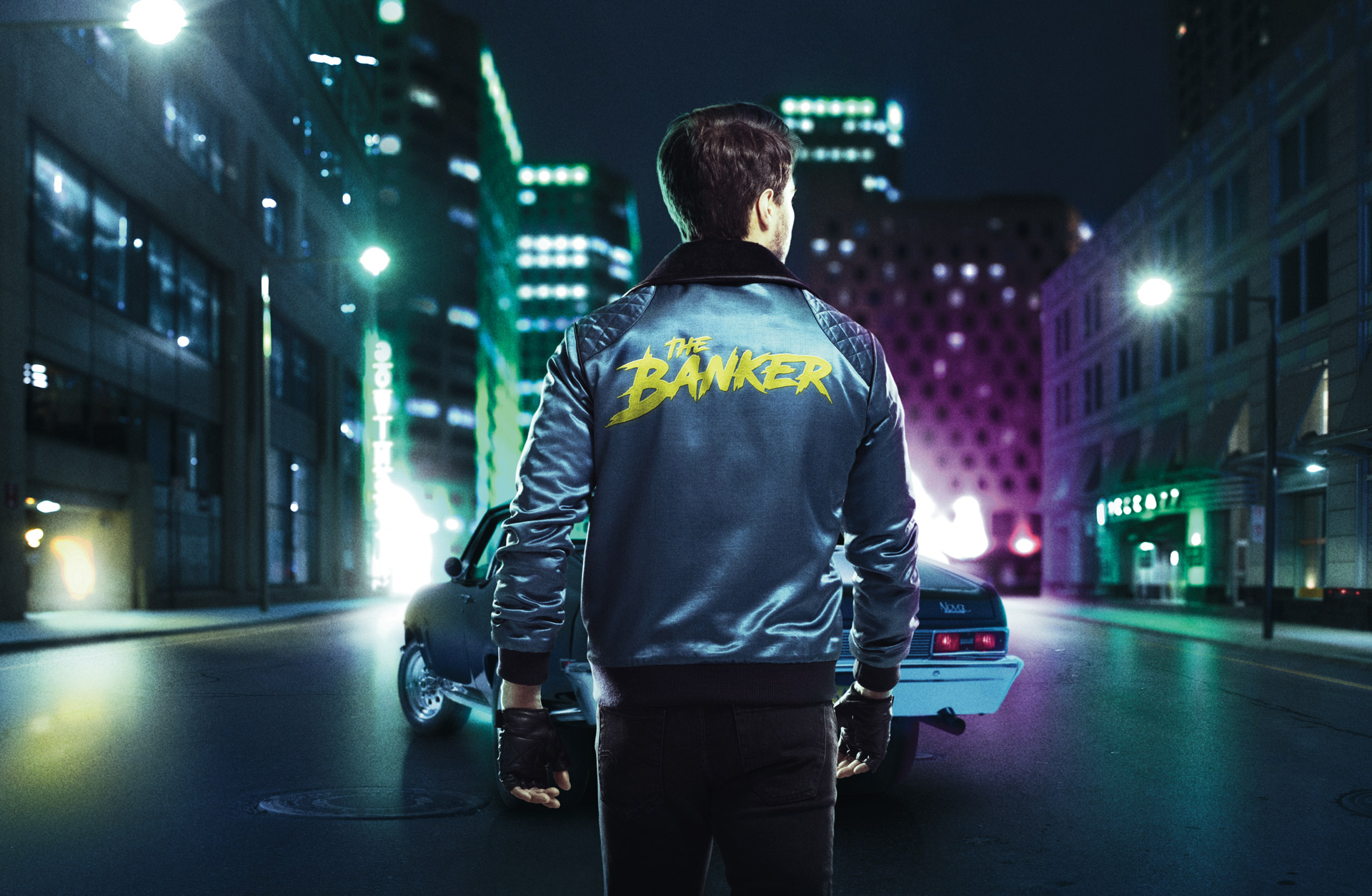"man from back walking towards car in colored lighting wearing leather jacket with ""The Banker"" written on the back photographed by Simon Duhamel for bank BNP Paribas"