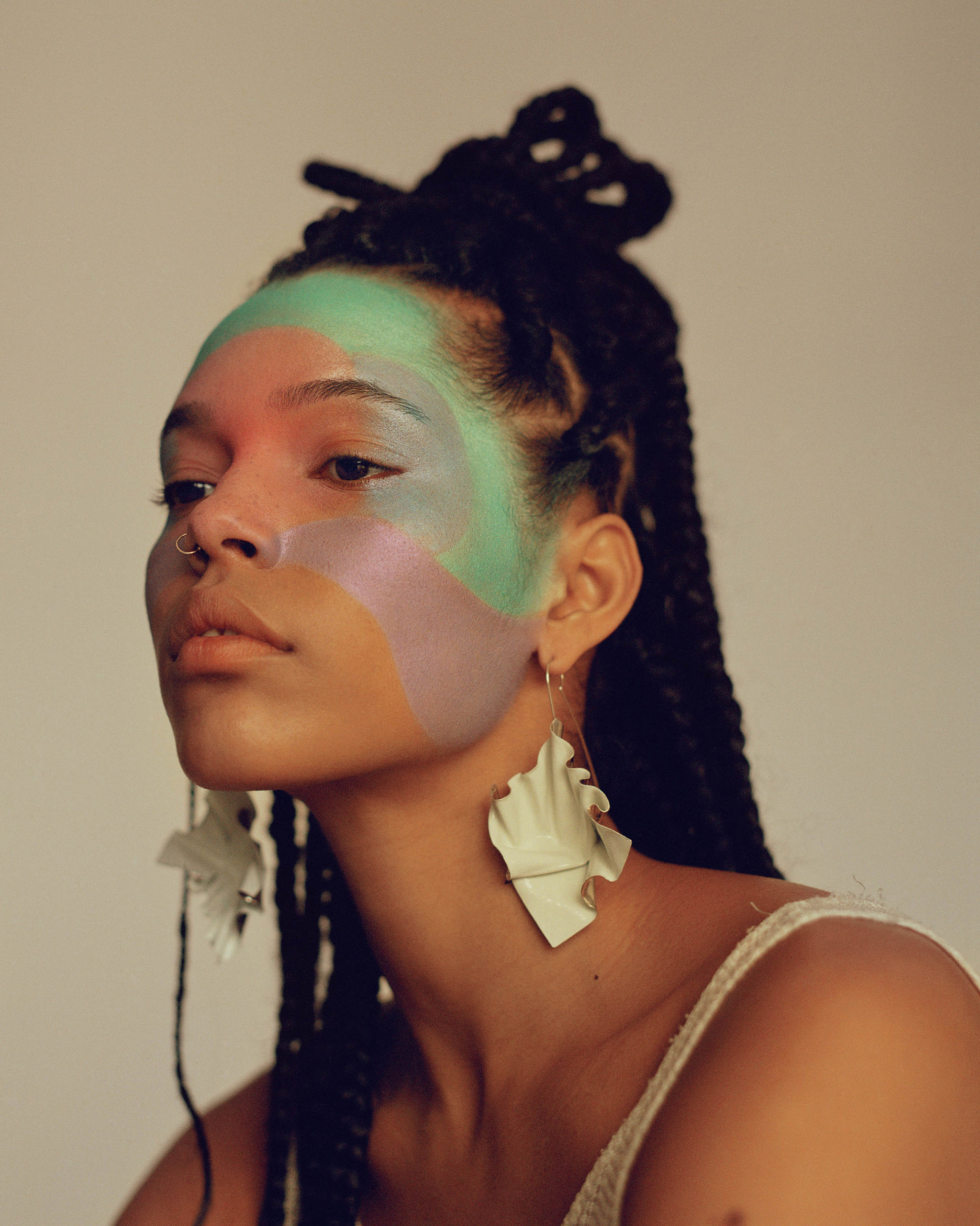 black model with purple and green make up for vogue arabia