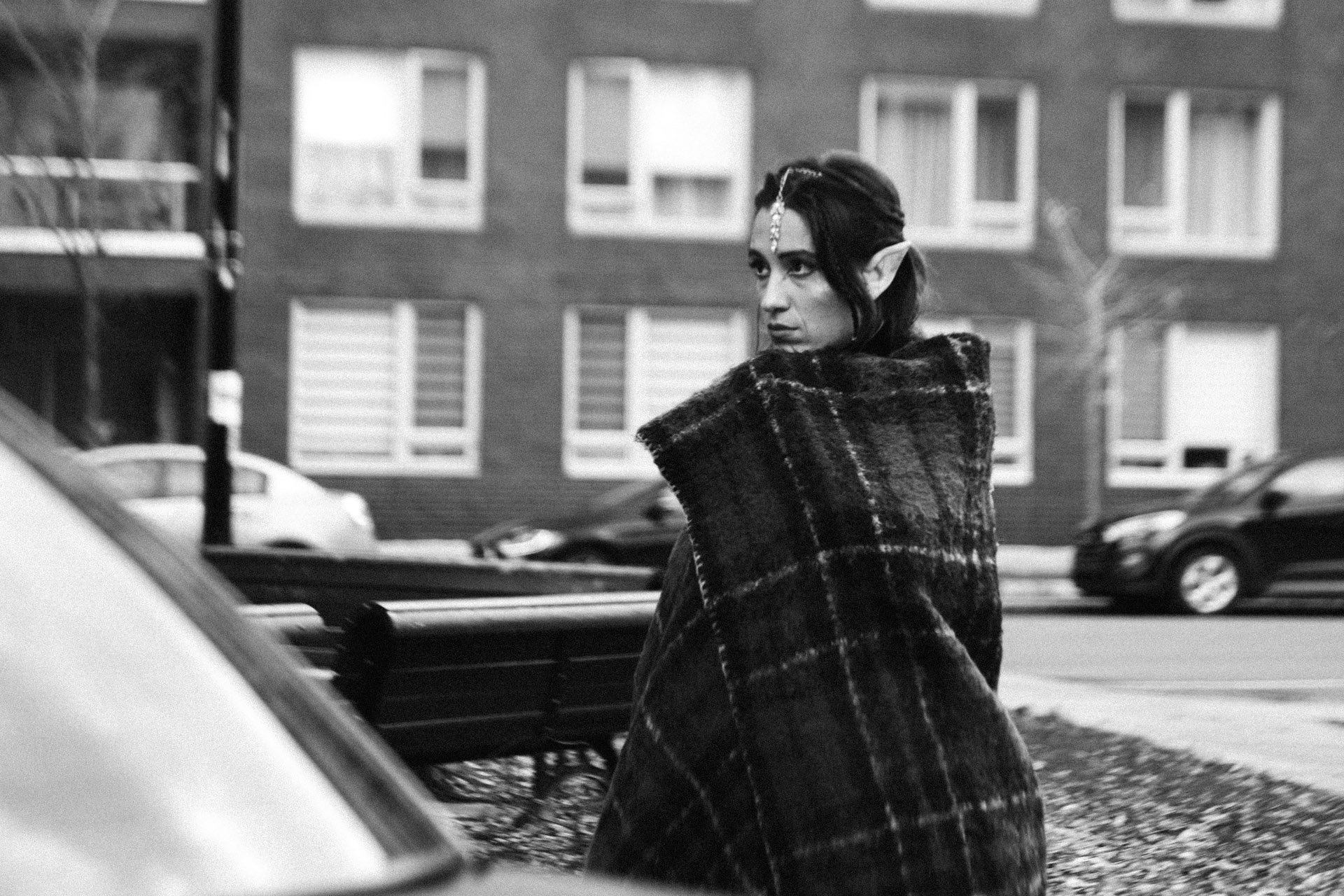 actress dressed as an elf outside keeping blanket snug around her in behind the scenes of TV series La Loi C'est La Loi filmed by Les Gamins for TV5 Unis