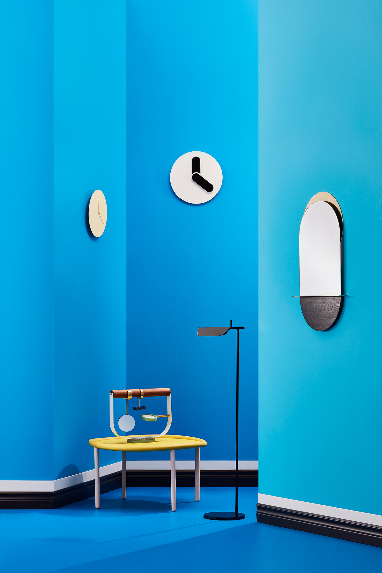 interior design with blue theme with low yellow side table clocks on the wall and small mirroir by Mathieu Levesque