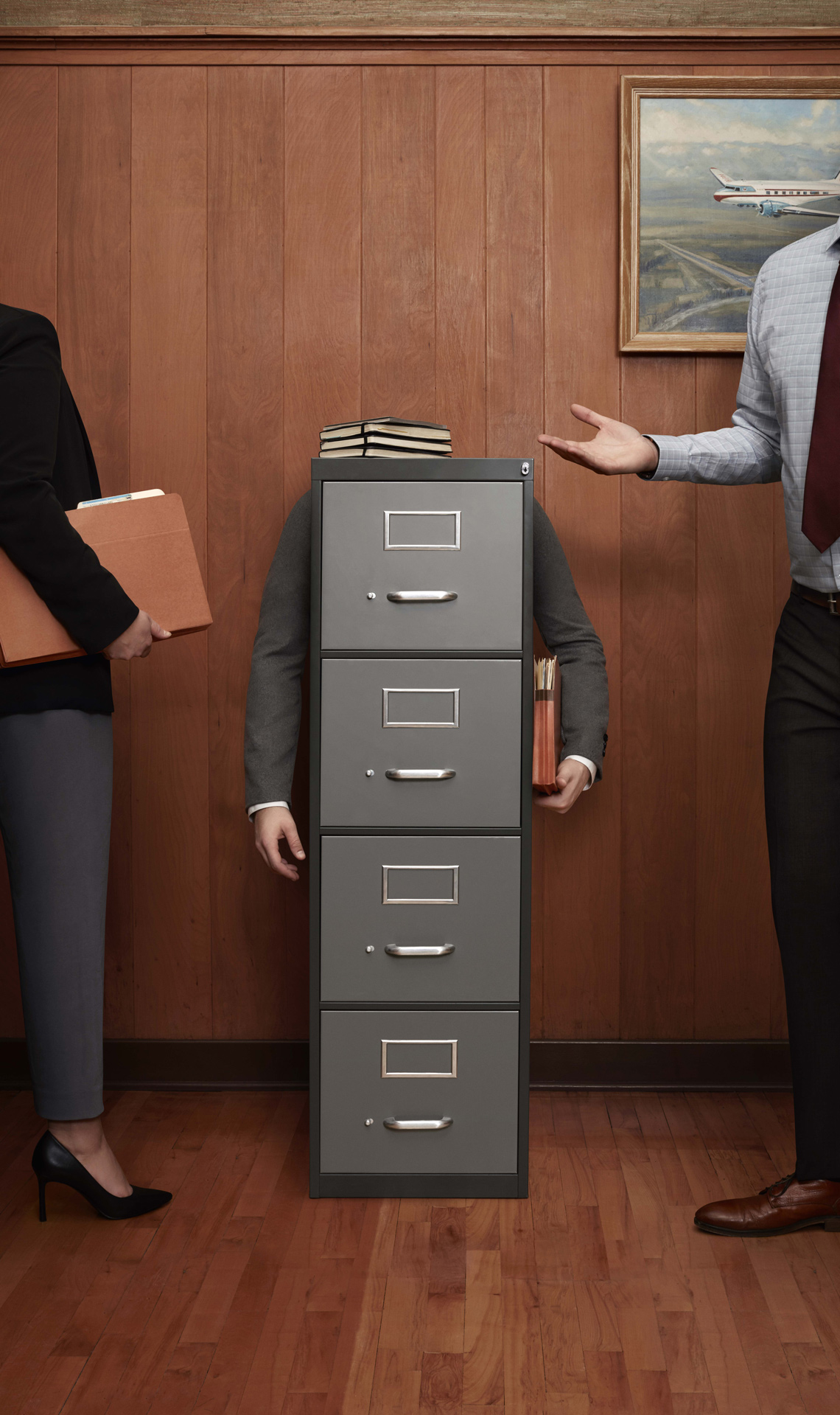 person disguised as a filing cabinet surrounded by other people by Simon Duhamel for Berlitz and Rethink