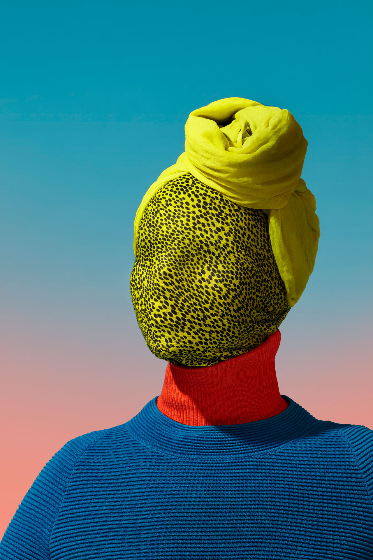 woman face covered in yellow cheetah-printed fabric head scarf blue textured sweater by Simon Duhamel for creative project SAND