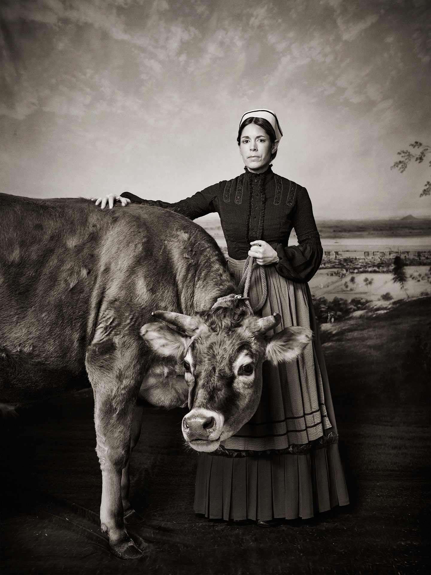 fake old picture of girl presenting a cow for SPCA 150th anniversary by Jocelyn Michel