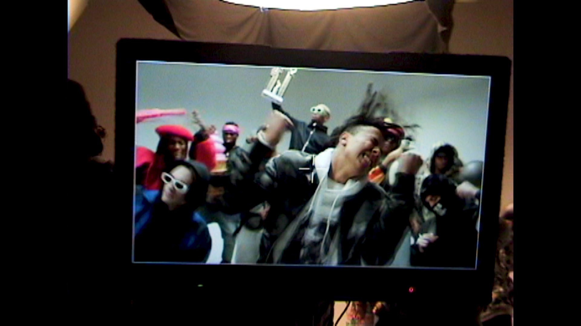 group of black people dancing with rapper Zach Zoya in the middle for music video Who Dat filmed by Les Gamins