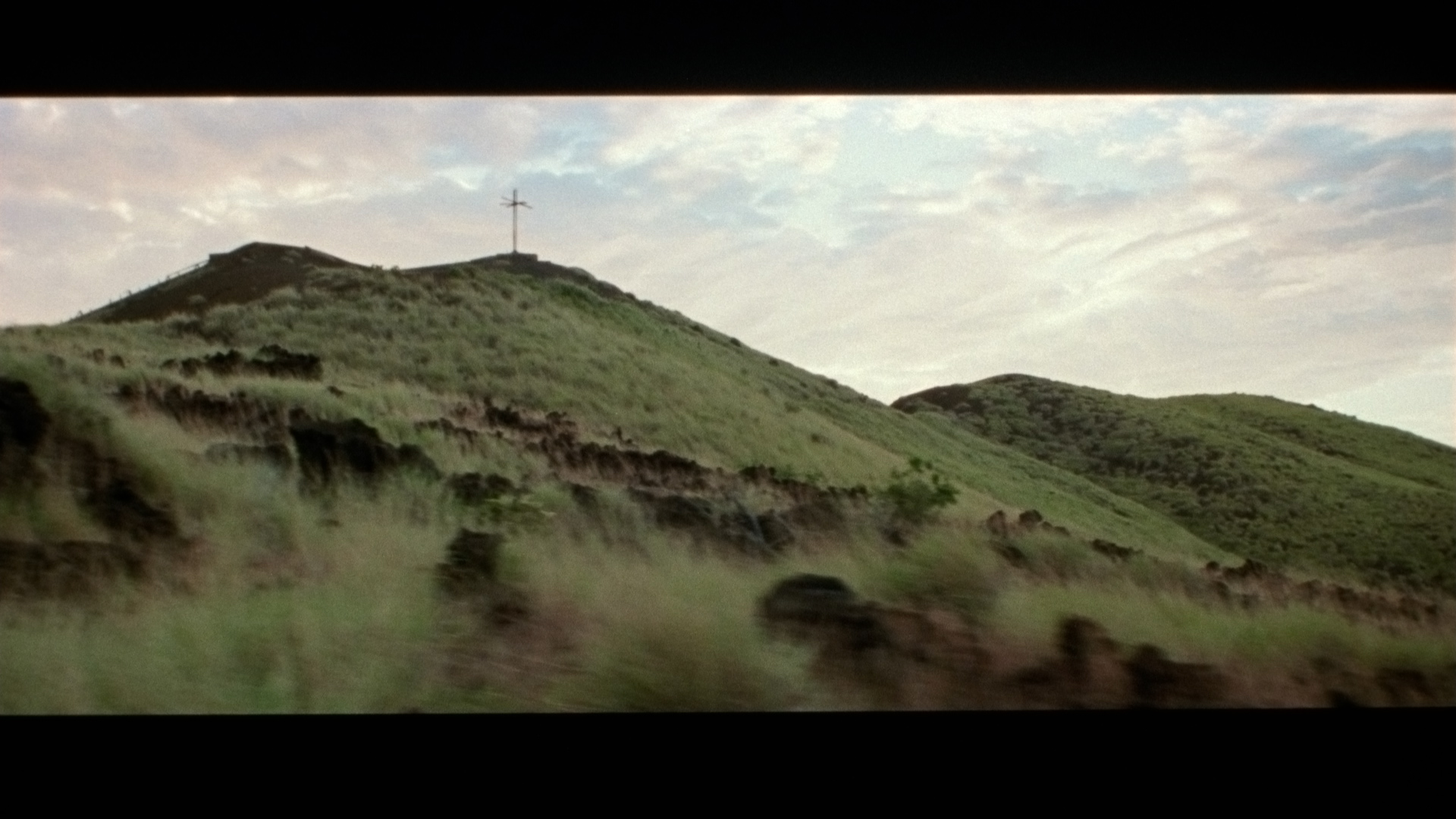 green hills seen from the road for singer Karim Ouellet music video of La Mer A Boire filmed by Les Gamins