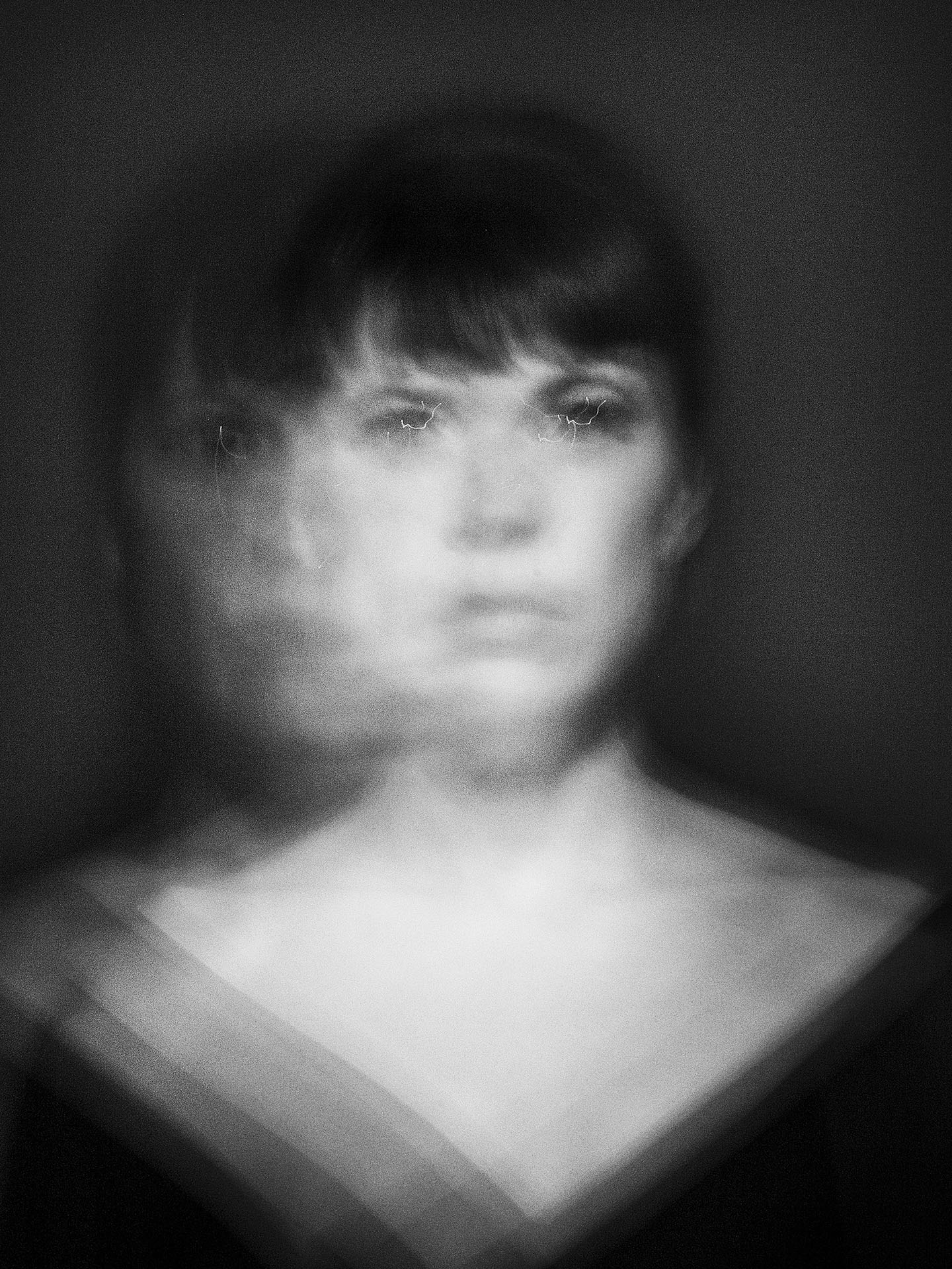 portrait of Anne Dorval in black and white with motion and blurred effect on black background by Jocelyn Michel for Voir
