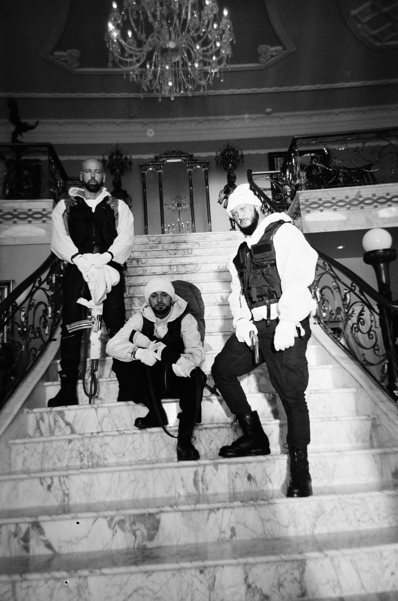 rapper Souldia with Sinik, Seth Gueko and Rick Pagano posing on marble stairs for his music video Rouge Neige filmed by Les Gamins