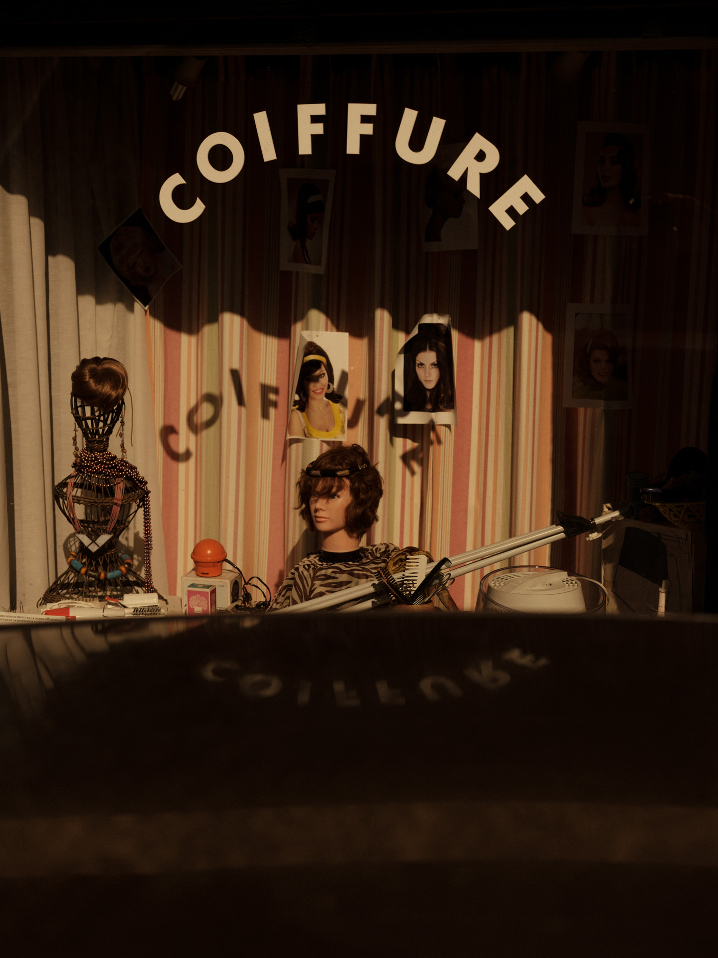 hairdresser shop window by Alexi Hobbs in Auvergne for Reflets de France